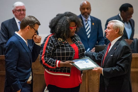 Michelle Browder is presented her Community Hero award by Montgomery Mayor Todd Strange, right, and Montgomery Advertiser Executive Editor Bro Krift during the city council meeting on Tuesday night October 16, 2018 in Montgomery, Ala.