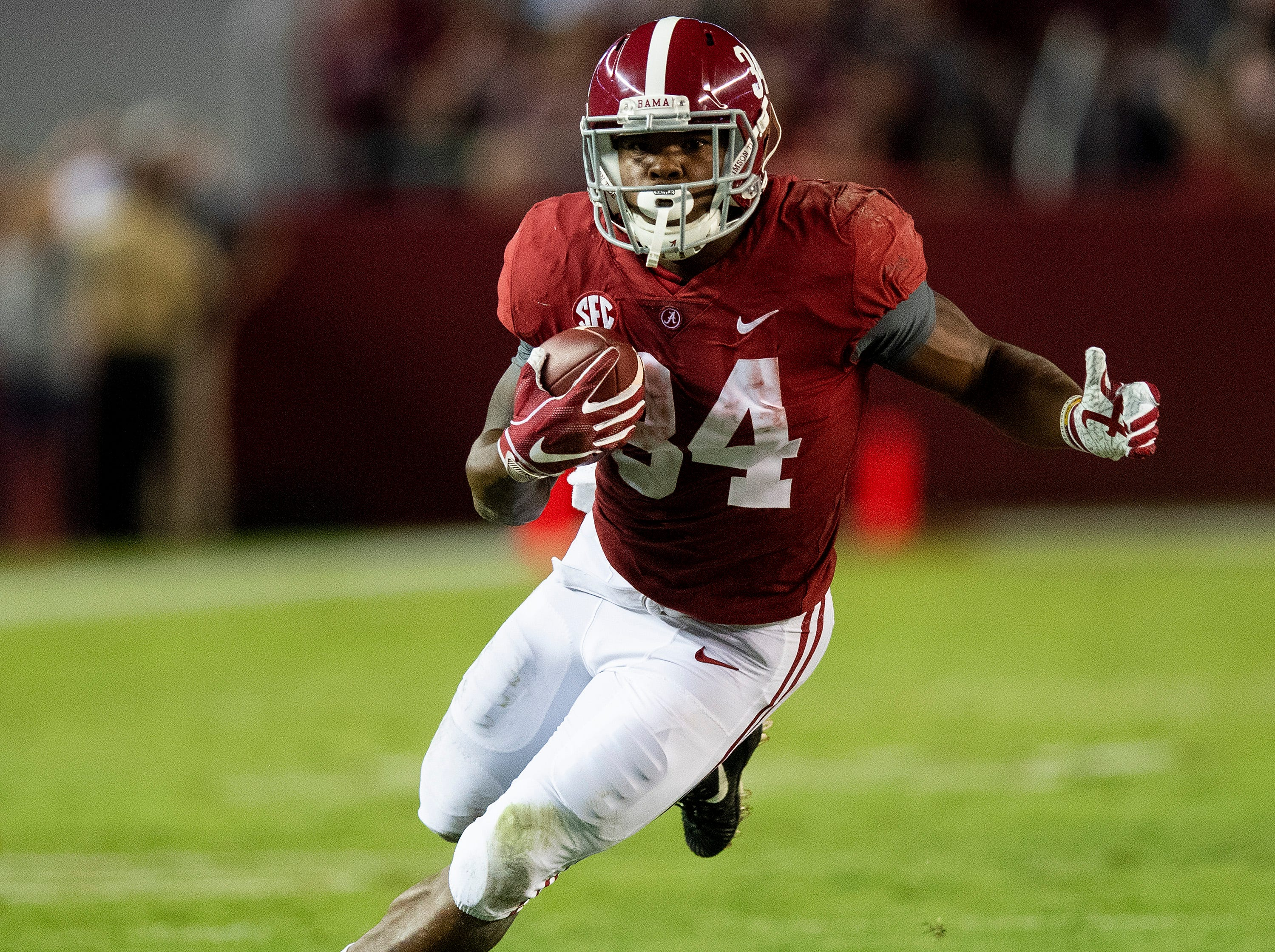 Alabama running back Damien Harris (34) carries the ball against Missouri in first half action at Bryant Denny Stadium in Tuscaloosa, Ala., on Saturday October 13, 2018.