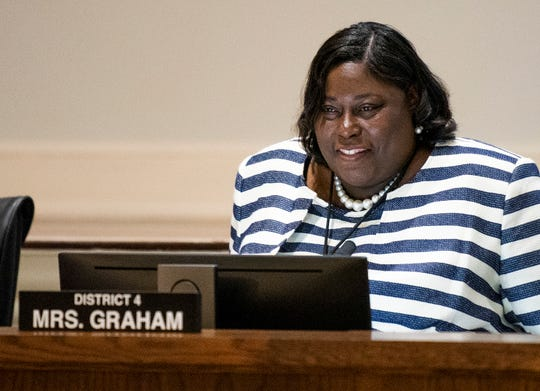 Audrey Graham takes her seat after she is sworn in as Montgomery's newest city council member at city hall on Tuesday night October 16, 2018.