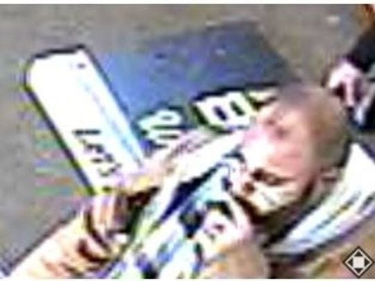 A surveillance photo released by police of the suspect in the attack on Greg Collett.