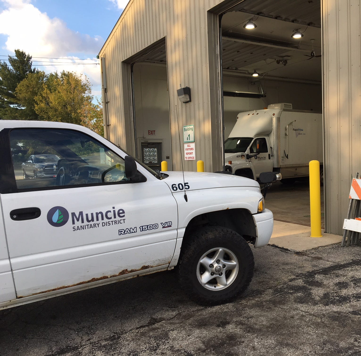 Barn and vehicles at the Muncie Sanitary District engineering offices.