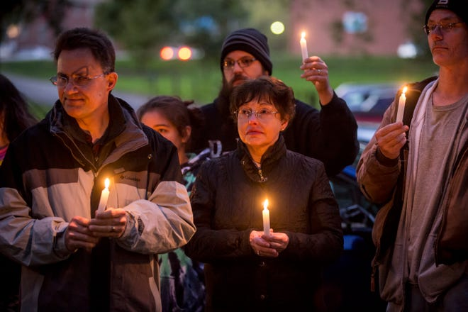 Family and friends gather at Westside Park on Oct. 16 for a candlelight vigil honoring Joe Minor Jr. The 27-year-old Muncie man was fatally injured on Oct. 5 when he was struck by a hit and run driver along South Morrison Road.