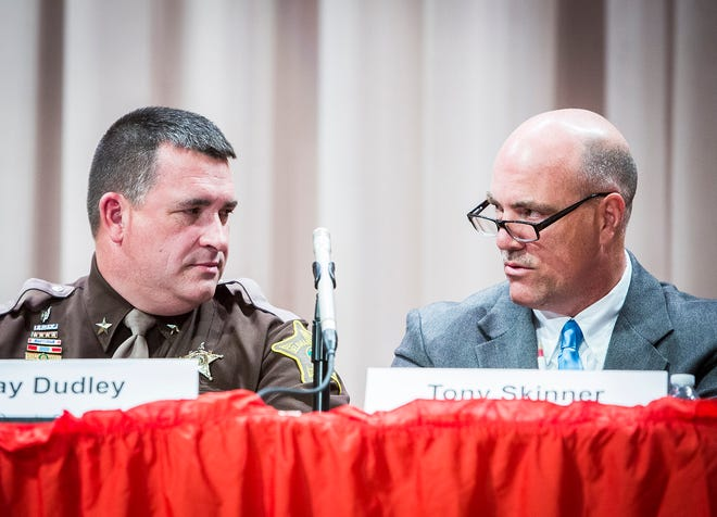 Sheriff Ray Dudley (left) and Republican candidate for sheriff Tony Skinner participate in a forum hosted by the League of Women Voters at Northside Middle School Wednesday evening.