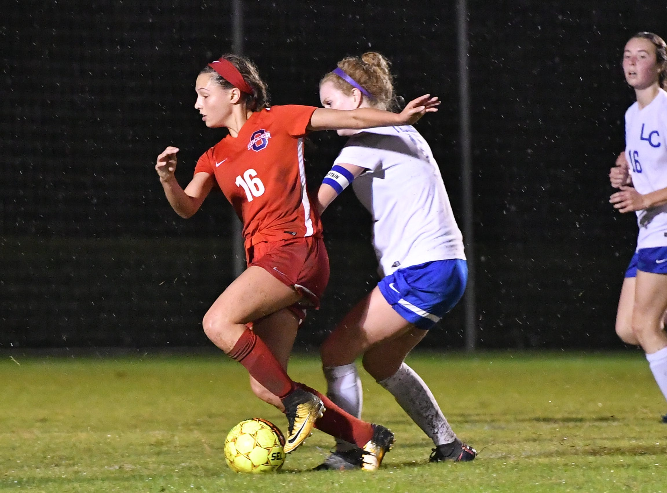 Oakland's Faith Adams battles a Lincoln County defender during Tuesday's region semifinals.