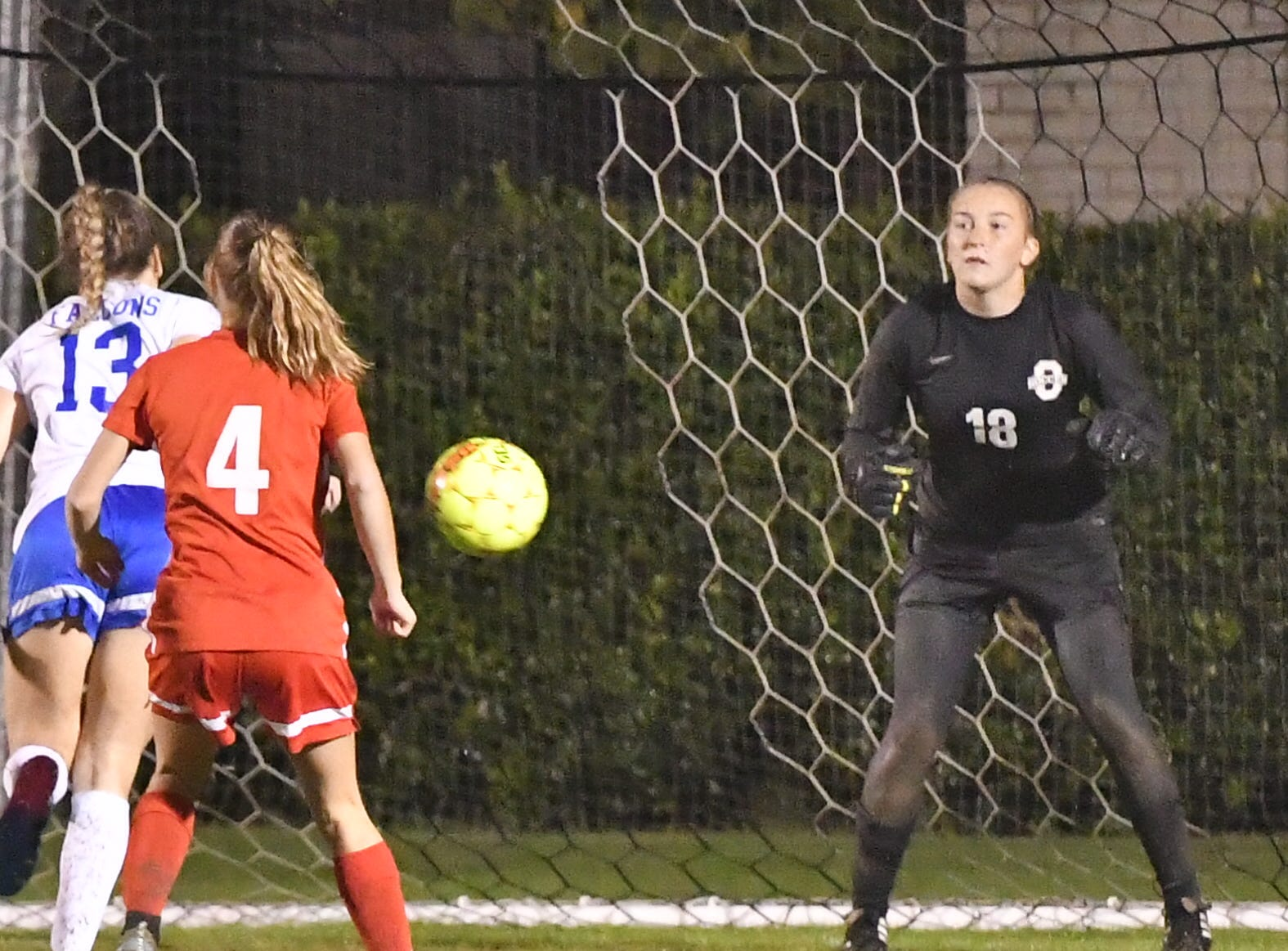 Oakland goalkeeper Sophie Turner awaits a Lincoln County kick as Lady Patriot defender Anna Bobo (4) looks on Tuesday.