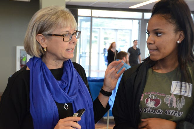 Deb Sells, MTSU vice president of student affairs, offers advice to Diamond Bryant during a September True Blue Tour stop in Clarksville. MTSU has again expanded scholarship opportunities to students in and outside of Tennessee.