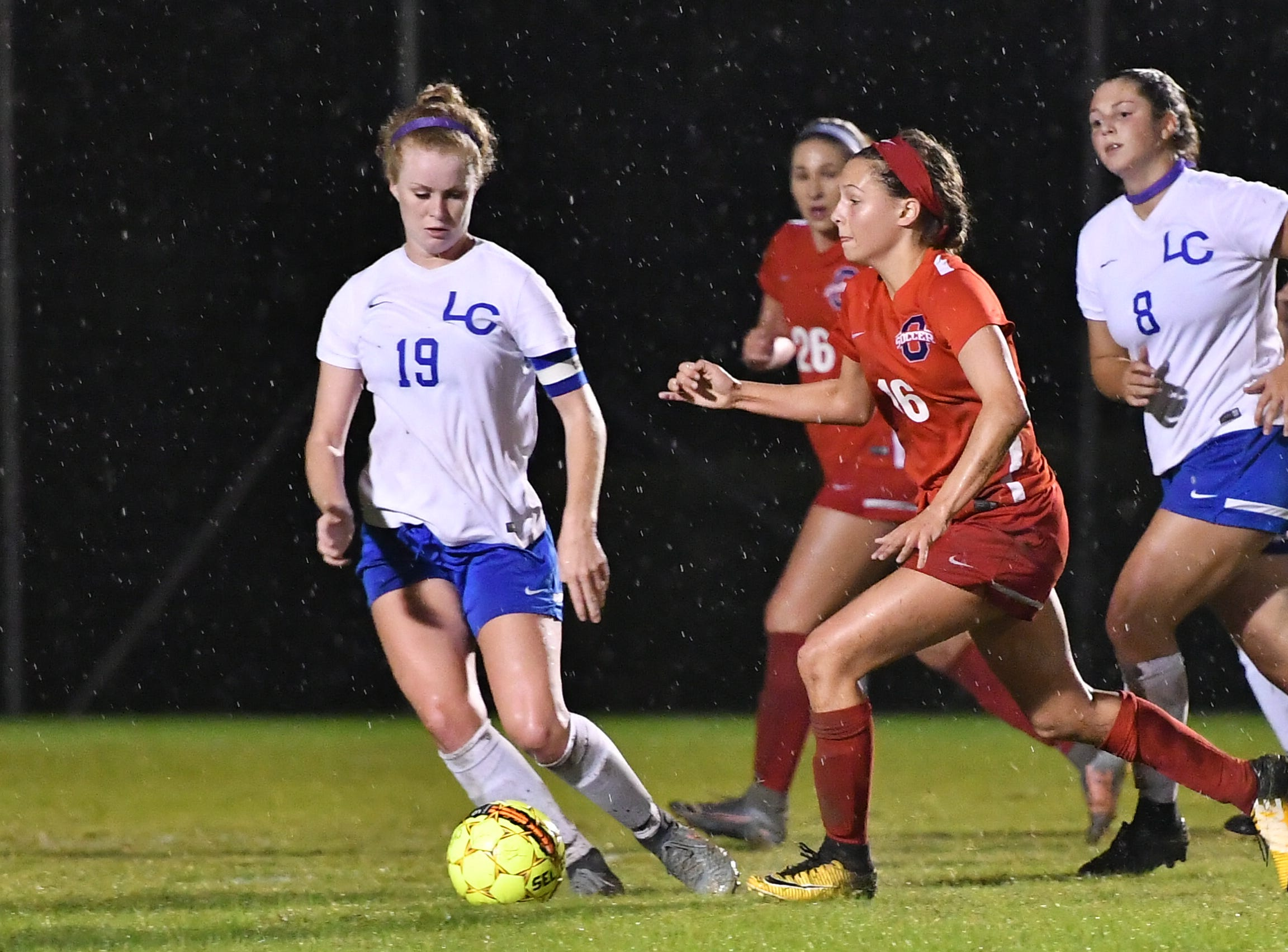 Lincoln County's Julia Marsh possesses the ball under pressure from Oakland's Faith Adams (16)