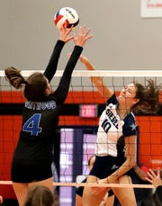 Siegel's Grace Reidmililer (10) goes for a kill during a 2018 match.