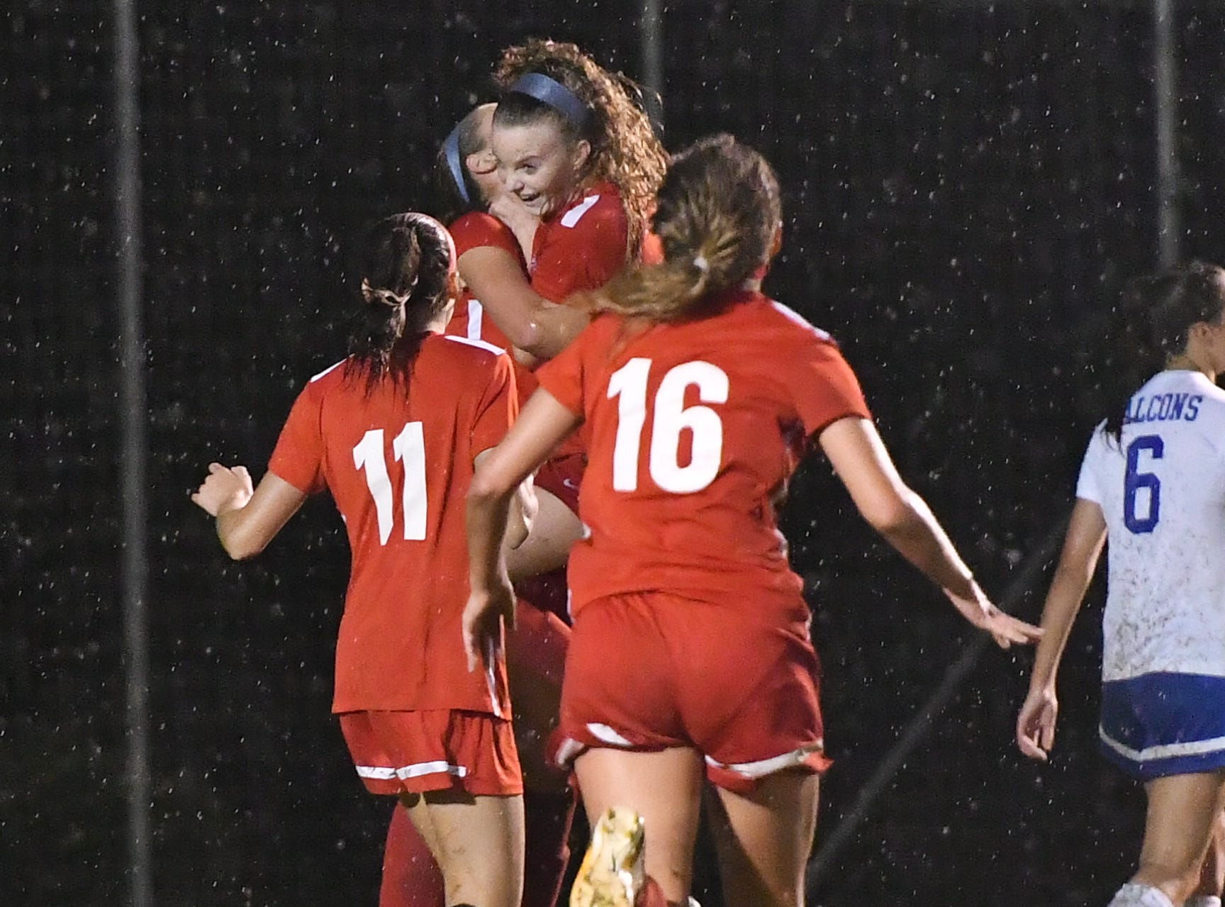 Oakland players celebrate Matty Snow's first-half goal during Tuesday's 2-1 OT win over Lincoln County in the 4-AAA semis.