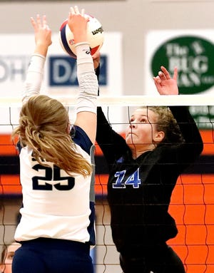 Brentwood's Shaye Eggleston (14) faces off with Siegel's Sophia Bossong (25) at the net during day two of the TSSAA Class AAA State Girls Volleyball tournament at Blackman, on Wednesday, Oct. 17, 2018.