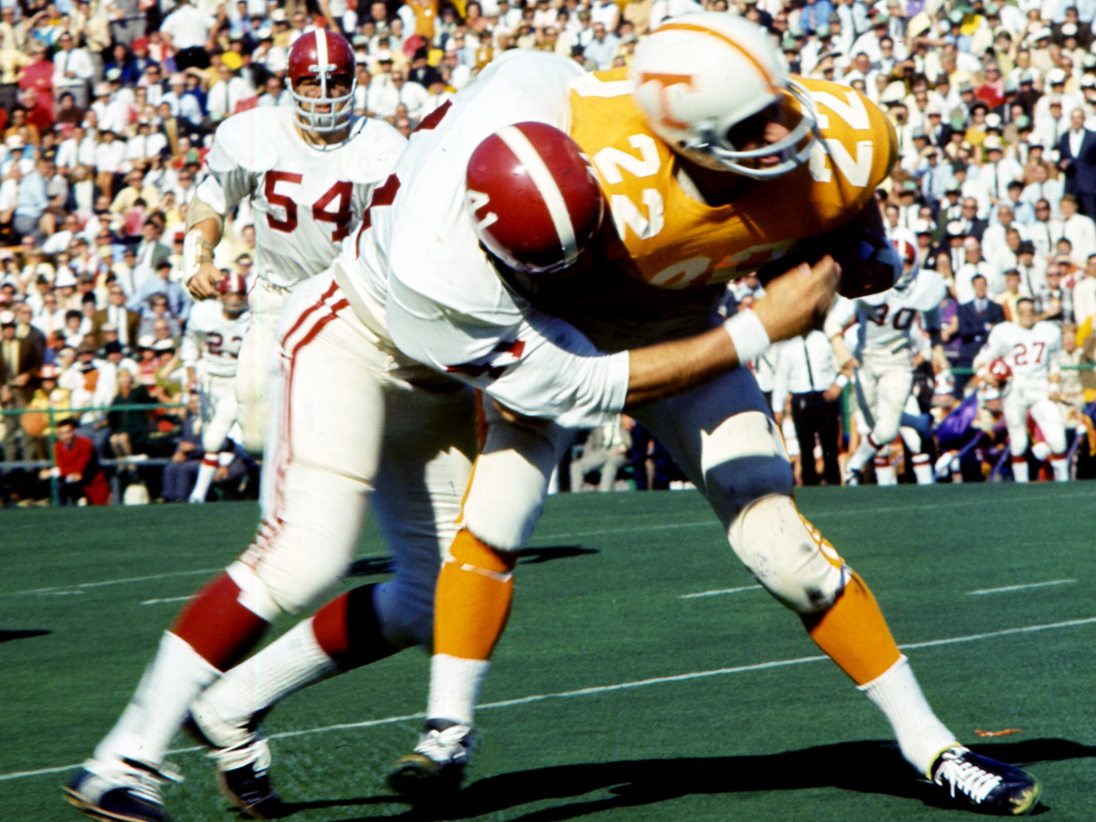 Tennessee senior back Richmond Flowers (22) attempts to fight off an Alabama defender. Flowers played his last game against his home state school by picking up 74 yards on 20 rushes and 37 more on five passes at Neyland Stadium Oct. 19, 1968.