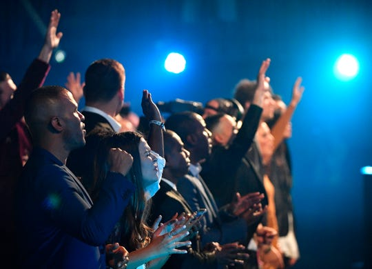 The audience breaks into worship as Cory Asbury performs during the 49th Annual GMA Dove Awards at Allen Arena Tuesday Oct. 16, 2018, in Nashville, Tenn.