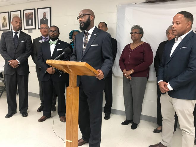 The Rev. James Turner II, the president of the Interdenominational Ministers Fellowship, speaks Wednesday at Jefferson Street Missionary Baptist Church during a news conference about souls to the polls initiatives.