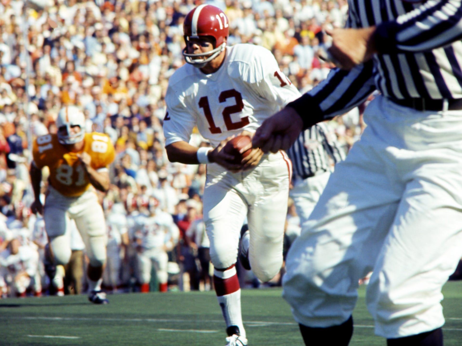 Alabama quarterback Scott Hunter (12) takes off running against Tennessee at Neyland Stadium Oct. 19, 1968.