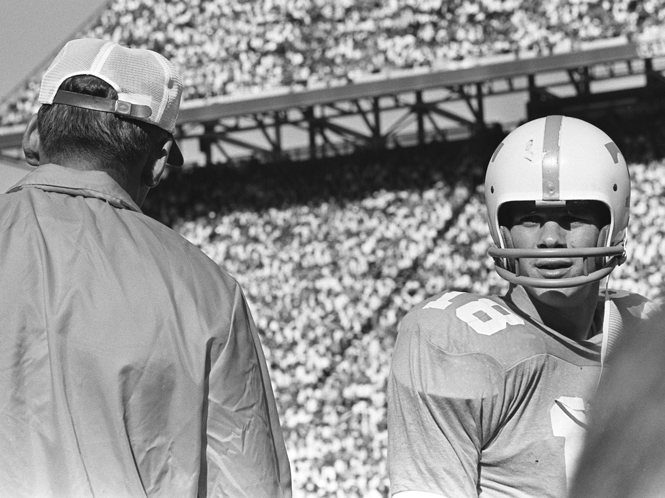 Tennessee senior quarterback Bubba Wyche (18) gets some instructions from head coach Doug Dickey before going back on the field against Alabama at Neyland Stadium Oct. 19, 1968.