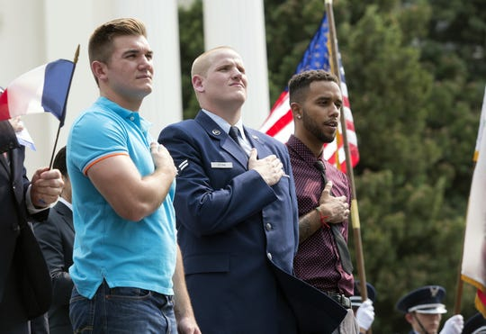 Oregon National Guardsman Alek Skarlatos, from left, U.S. Airman Spencer Stone and Anthony Sadler attend a parade in Sept. 11, 2015 to honor the three Americans who stopped a gunman on a Paris-bound passenger train, in Sacramento, Calif.