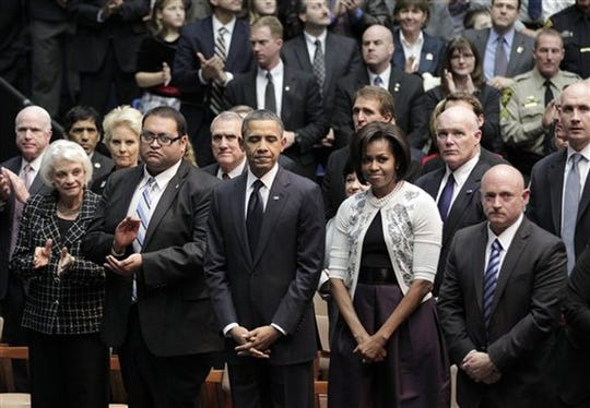 President Barack Obama and first lady Michelle Obama attend a memorial service for the victims of the 2011 Tucson shooting on Jan. 12, 2011. Daniel Hernandez is second from left.