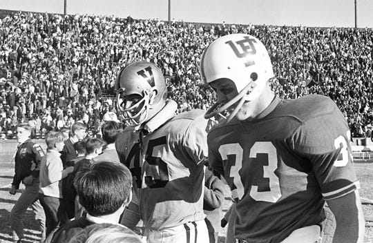 Chip Healy (45) of Vanderbilt and Larry Smith (33) of Florida greet some young fans at the end of a game. The Commodores and Gators tied 14-14 on Oct. 26, 1968.