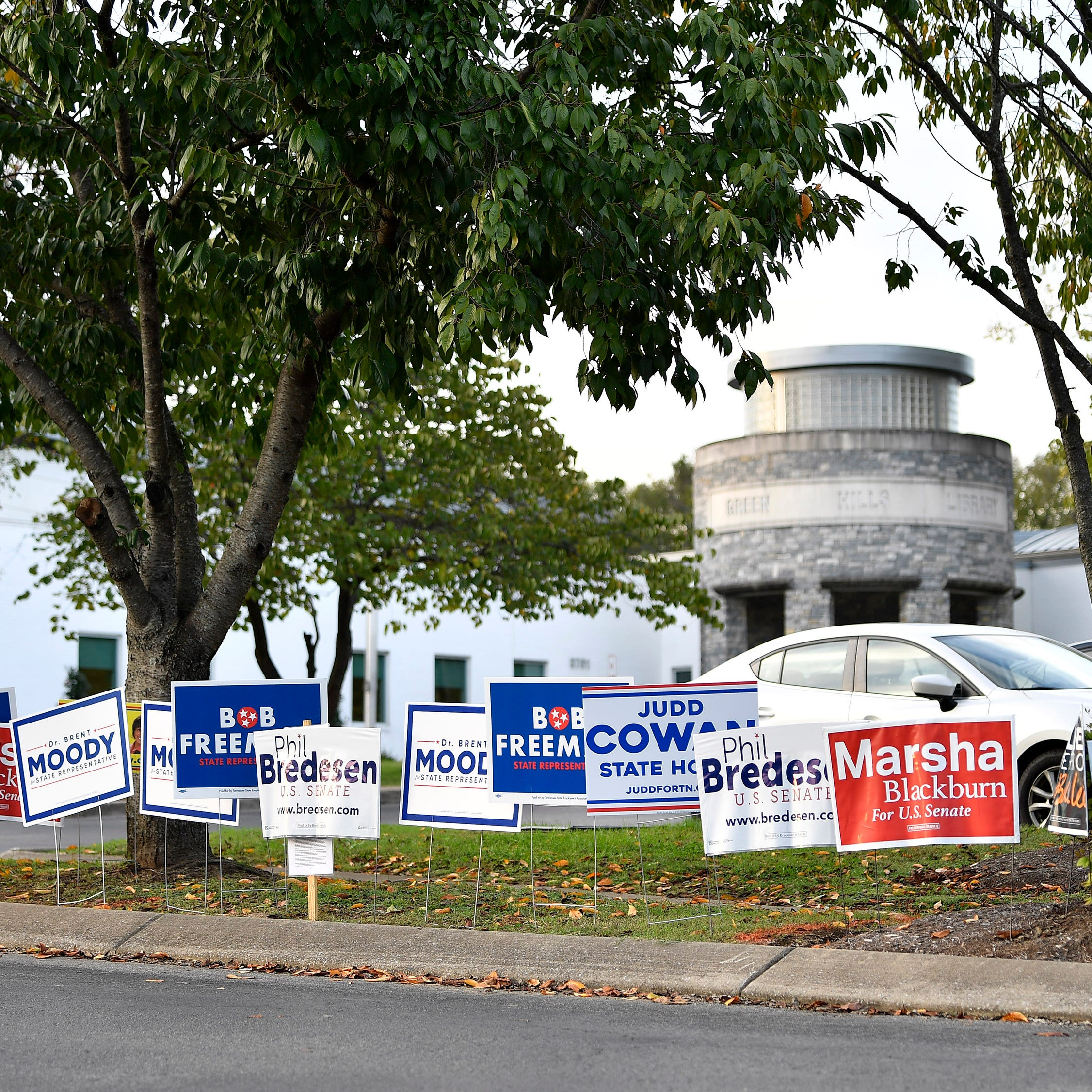 Political signs dot the grass outside the Green Hills Library Wednesday, Oct. 17, 2018, in Nashville, Tenn.