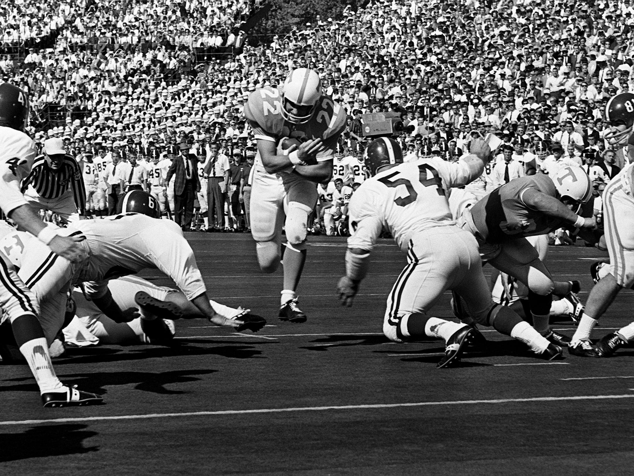 Tennessee senior back Richmond Flowers (22) heads for the hole but has Alabama linebacker Mike Hall (54) waiting for him. Flowers played his last game against his home state school by picking up 74 yards on 20 rushes and 37 more yards on five passes at Neyland Stadium Oct. 19, 1968.