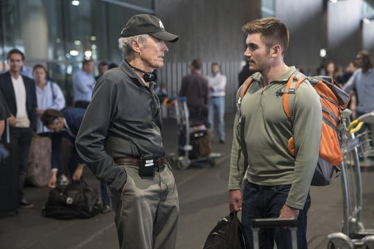 "Director/producer Clint Eastwood and Alek Skarlatos on the set of the film ""The 15:17 to Paris."""
