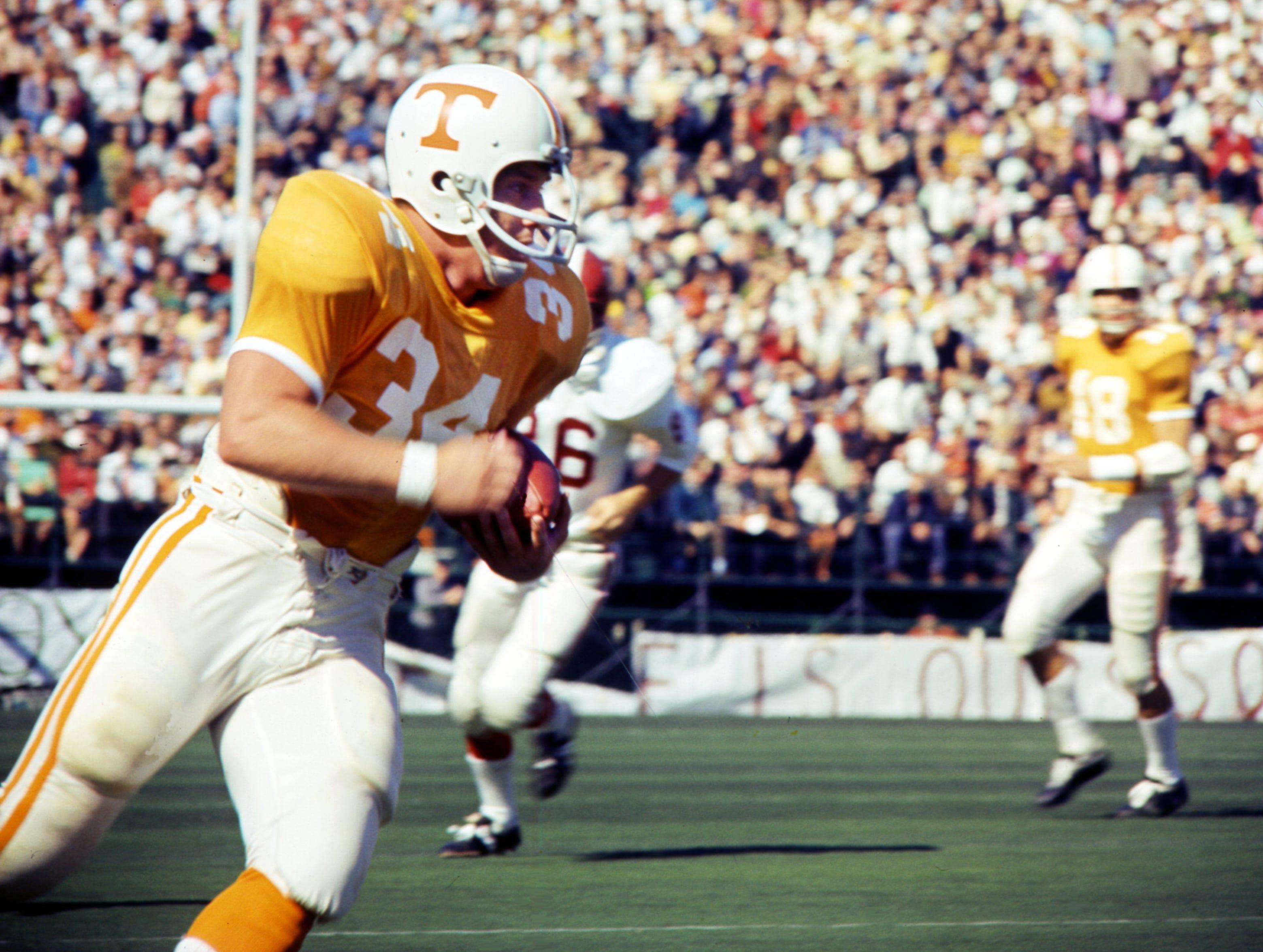 Tennessee senior fullback Richard Pickens (34) heads up field against Alabama before 63,392 fans at Neyland Stadium Oct. 19, 1968.