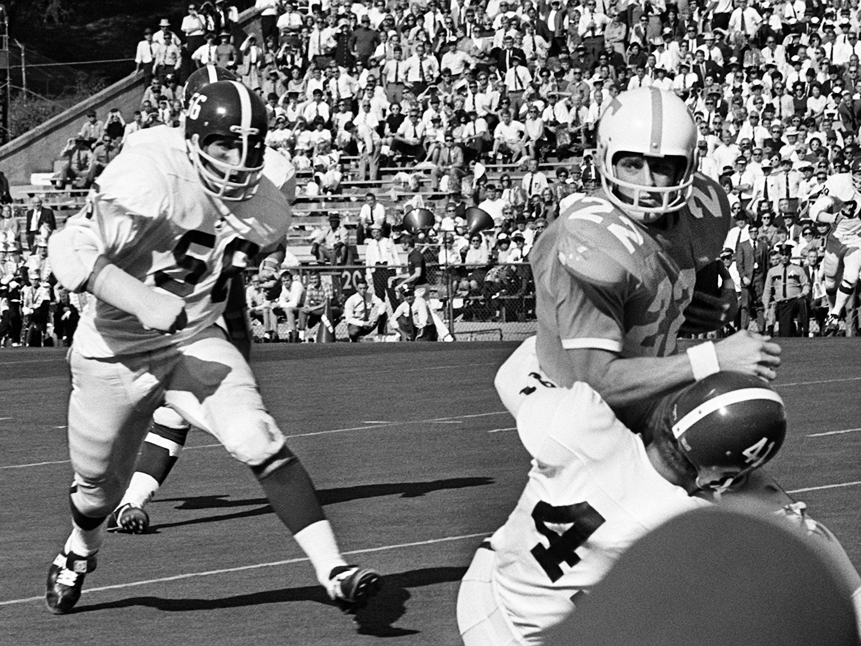 Tennessee senior back Richmond Flowers (22) gets stopped by an Alabama defender before at Neyland Stadium Oct. 19, 1968.