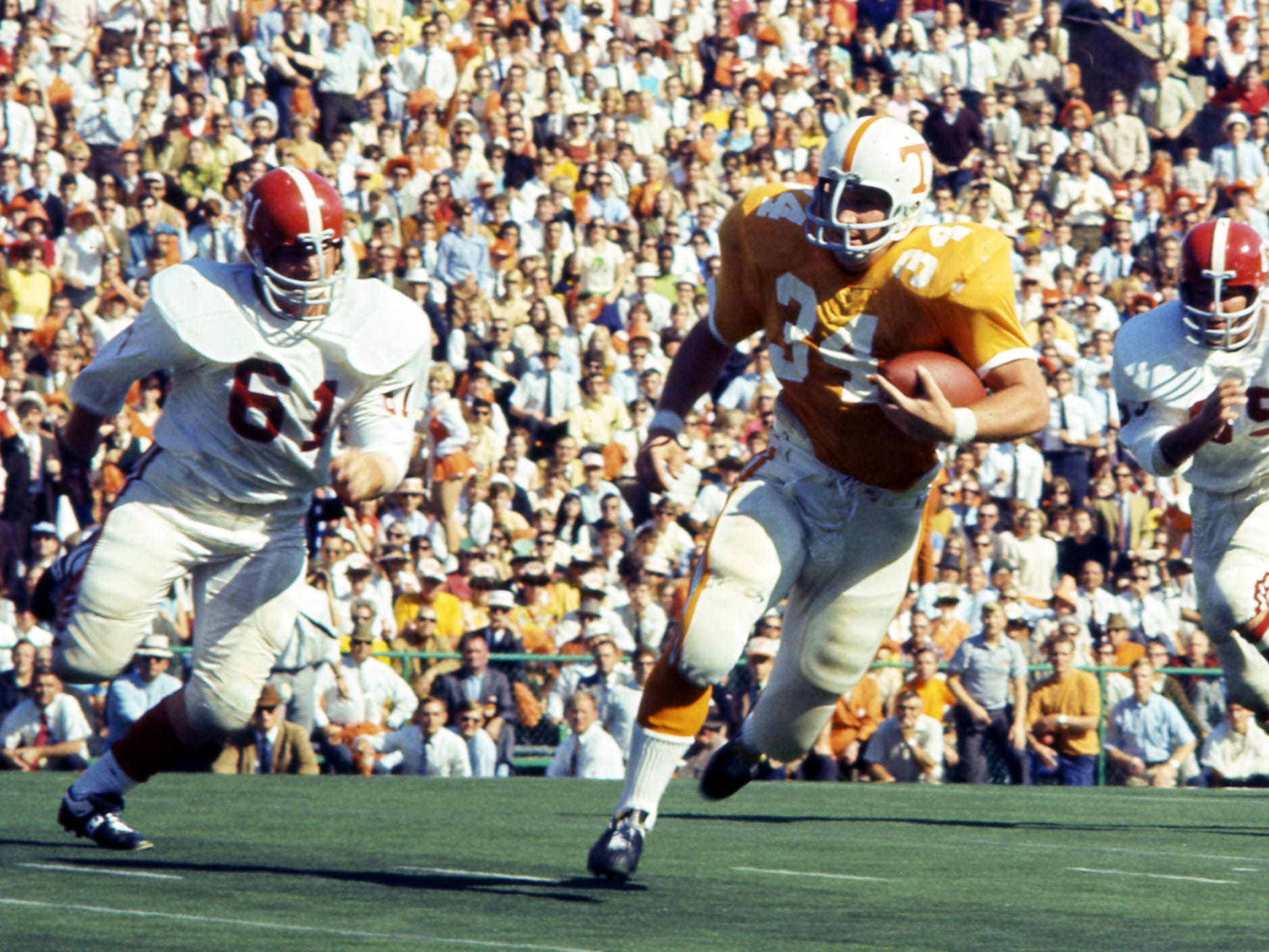 Tennessee senior fullback Richard Pickens (34) heads up field as a couple of Alabama defenders give chase at Neyland Stadium Oct. 19, 1968.