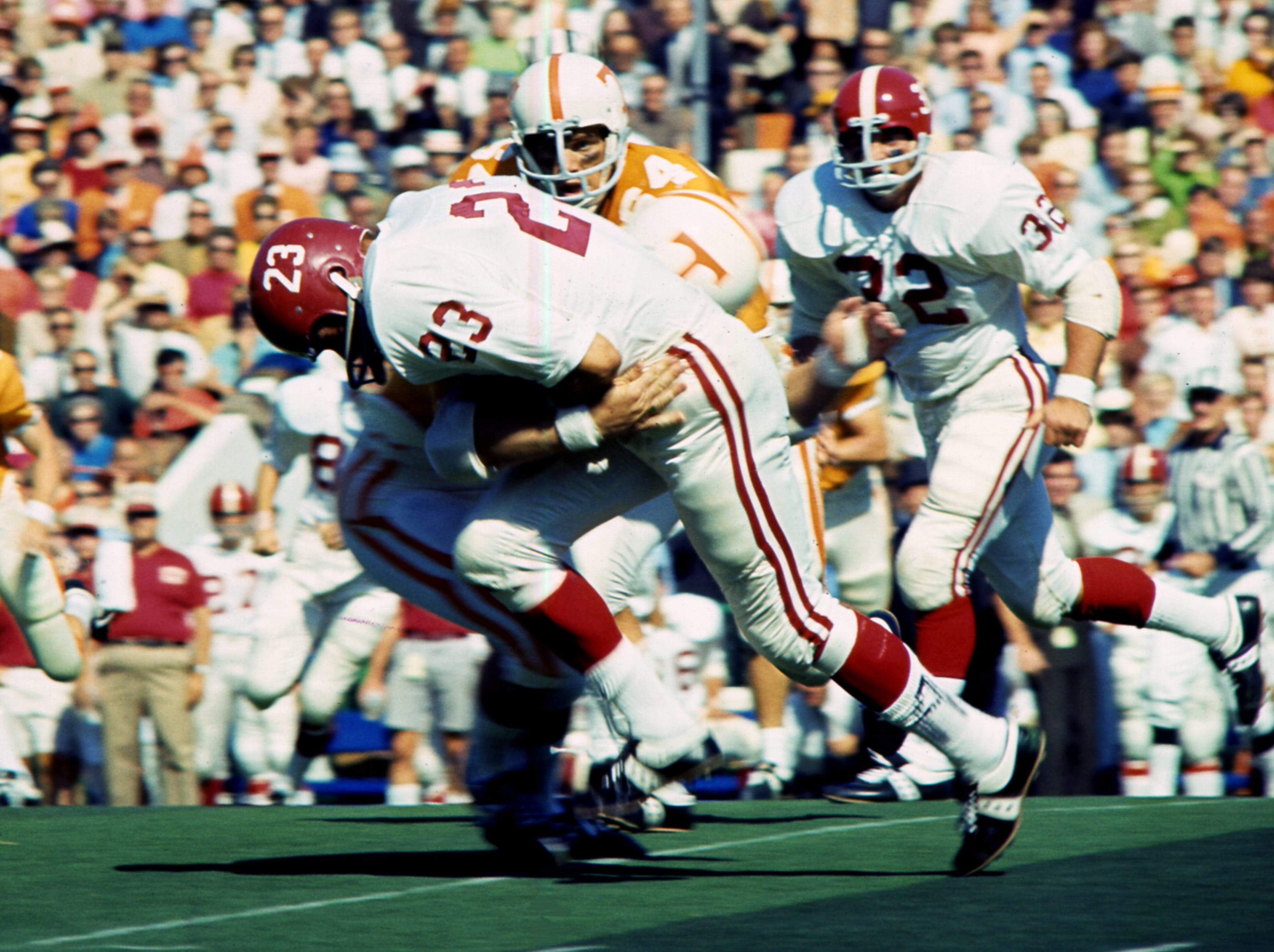 Alabama running back  (23) attempts the break the tackle of a Tennessee defender. Tennessee survive a missed two-point conversion, an onside kick and a missed field goal in the final minute and 12 seconds to win 10-9 over Alabama before 63,392 fans at Neyland Stadium Oct. 19, 1968.