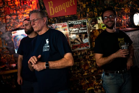 From left, Zac Blue, Tom Ross, and Jordan Pruitt watch other competitors during a dart league event at The Villager Tavern in Nashville, Tenn., Tuesday, Oct. 16, 2018.