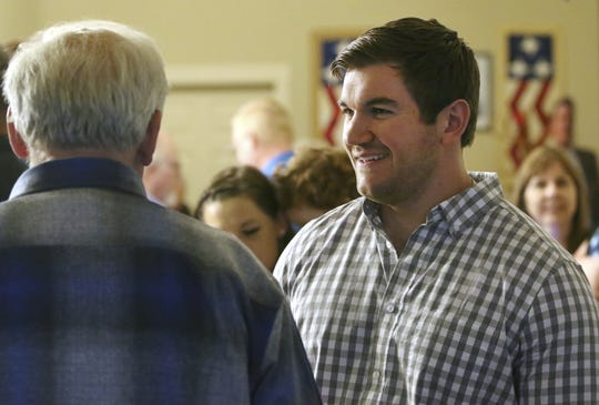 Alek Skarlatos, right, speaks with former Douglas County Commissioner Mike Winters at the Douglas County Republican Party headquarters in Roseburg, Ore., Tuesday, May 15, 2018. Earlier in the evening Skarlatos announced his intent to run for the Douglas County Commissioner seat recently vacated by Gary Leif.
