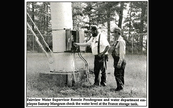 City employees check tank levels during Fairview's 1995 water shortage.