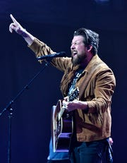 Zach Williams performs at the 49th Annual GMA Dove Awards at Allen Arena