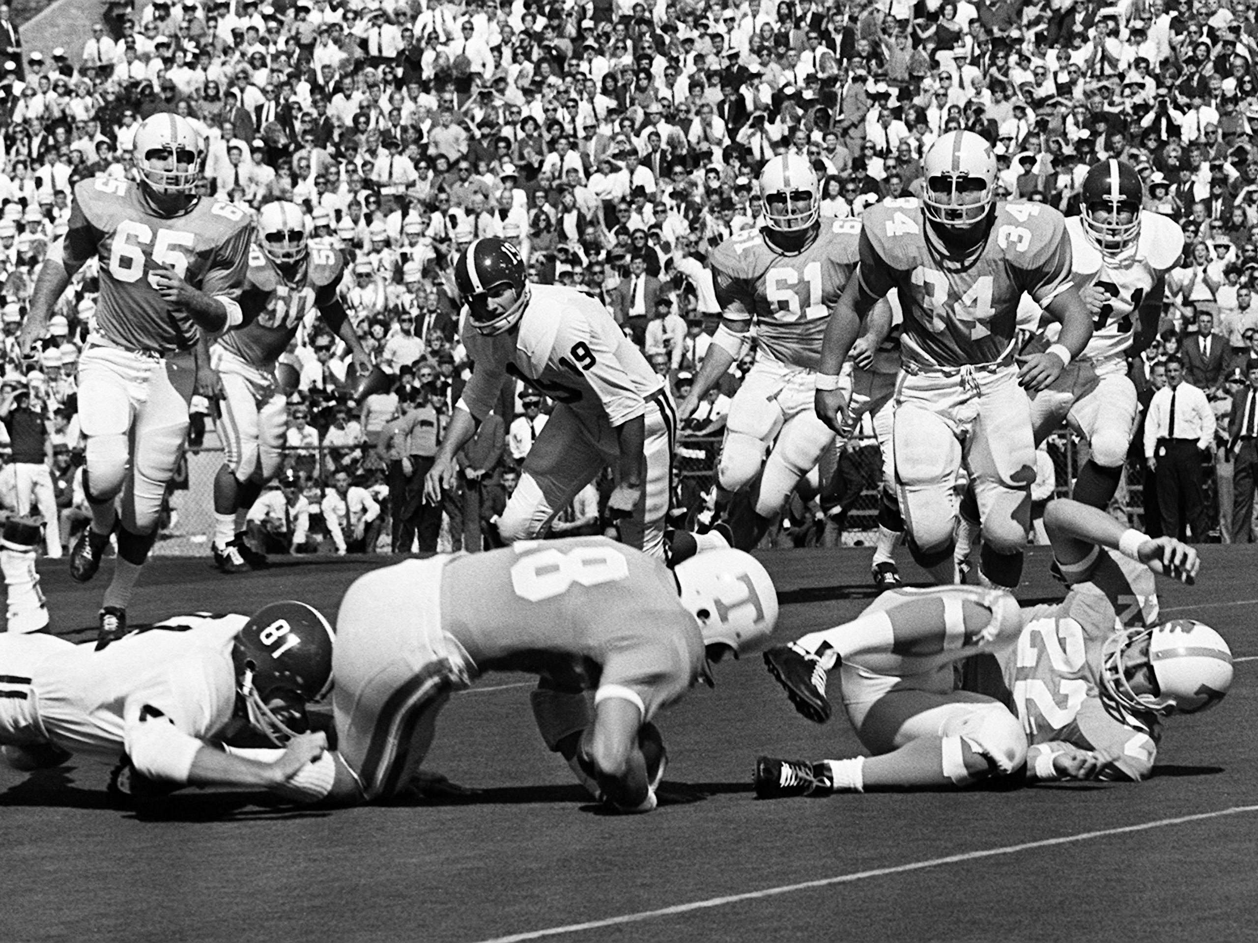Tennessee senior quarterback Bubba Wyche (18) has teammate Richmond Flowers (22) in front but get caught from behind by Alabama at Neyland Stadium Oct. 19, 1968.
