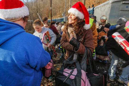 Amy Grant hands out packages at a stop on the CSX Santa Train trail through Appalachia in a past year. The train delivers toys, food and winter clothes to families on a 110-mile trek from Kentucky to Tennessee.