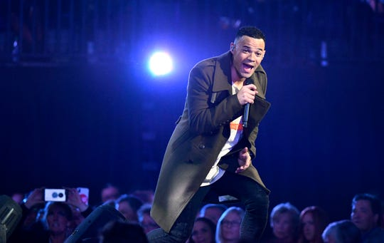 Tauren Wells performs during the 49th Annual GMA Dove Awards at Allen Arena