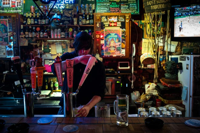 Bartender Austin Layda pours a drink at The Villager Tavern in Nashville, Tenn., Tuesday, Oct. 16, 2018.