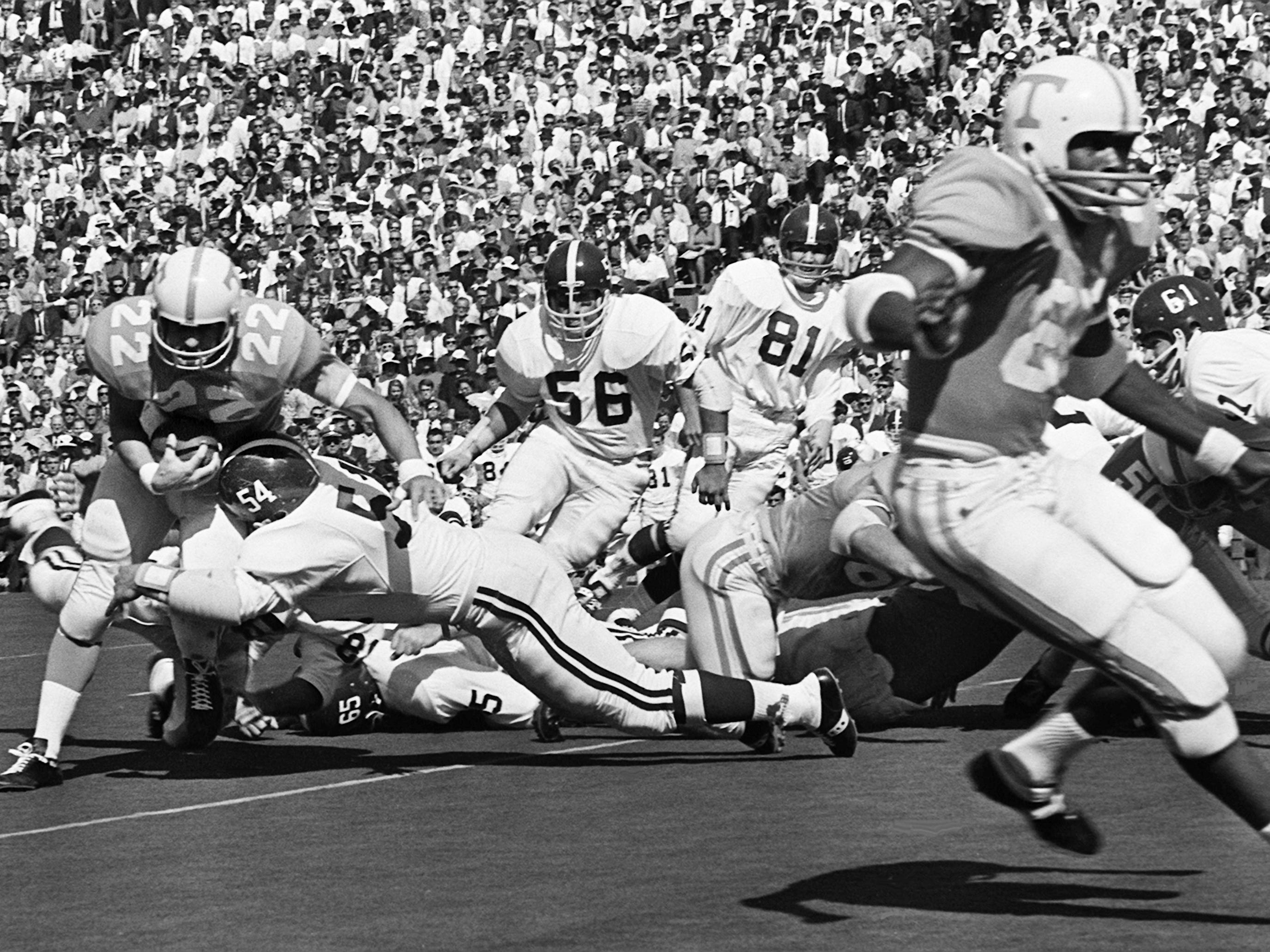 Tennessee senior back Richmond Flowers (22) gets hit by Alabama linebacker Mike Hall (54) before he can get started at Neyland Stadium Oct. 19, 1968.