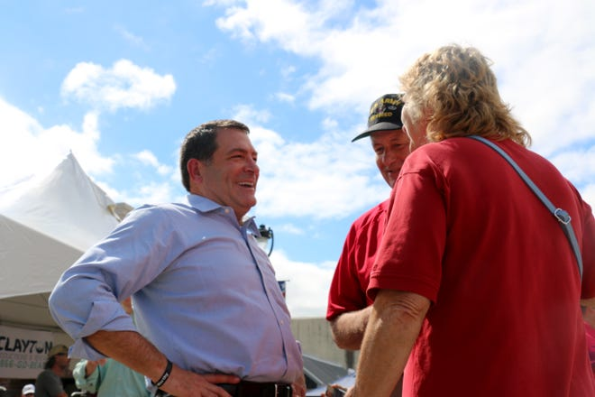 Sen. Mark Green leans back into a laugh as he talks with residents in Henderson, Tenn., on Sept. 28, 2018.