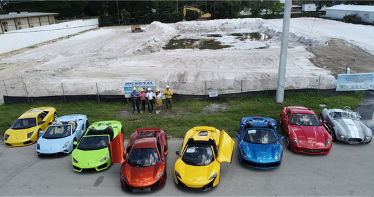 Cars line up for the groundbreaking of Ultimate Garages in Naples, which promises to bring exotic and classic car storage in Naples to the next level.