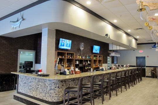 The bar at the new Shaking Crab restaurant in The Prado at Spring Creek retail center off U.S. 41. in Bonita Springs.