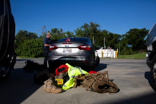 A team of 33 individuals from six fire-rescue stations in Collier County are driving up to the heavily impacted communities of Springfield and Callaway in Panama Beach City, on Wednesday Oct. 17, 2018, to relief their comrades who have been working at the location for over a week.