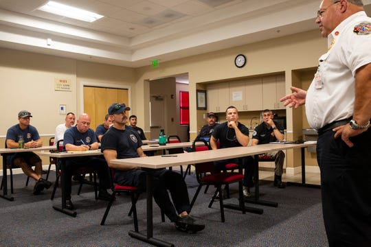 """Assistant Fire Chief, Nolan Sapp, talks to the relief team heading to Panama City Beach on Wednesday Oct. 17, 2018, about the code of conduct, their duties and their responsibilities. """"Remember, we are a team,"""" Snapp said."""