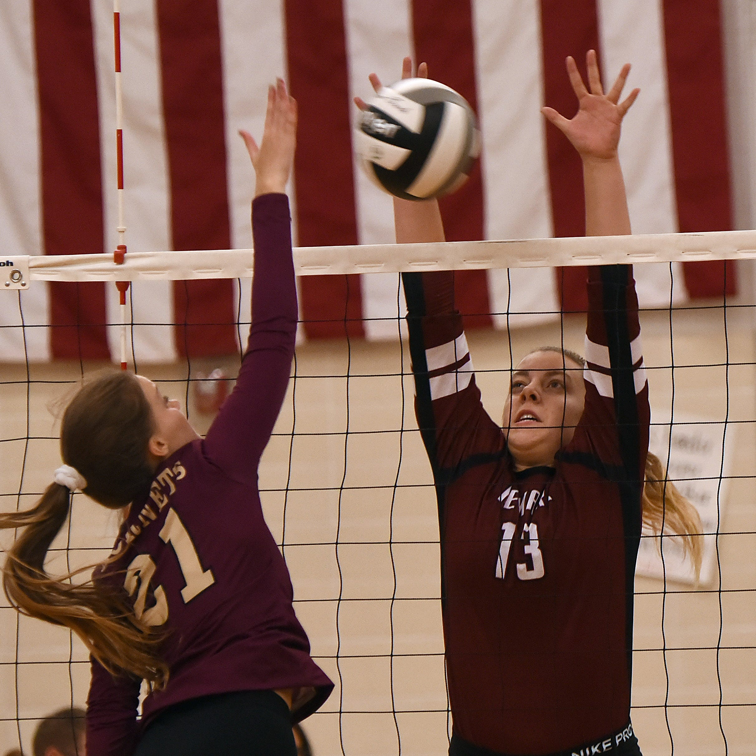 Licking Heights' Sofie Kibler spikes the ball at Newark blocker Sarah Houpt during a Division I first-round match on Tuesday, Oct. 16, 2018, at Newark High School. The Wildcats defeated the Hornets in four sets; 26-24, 25-20, 22-25, 25-15.