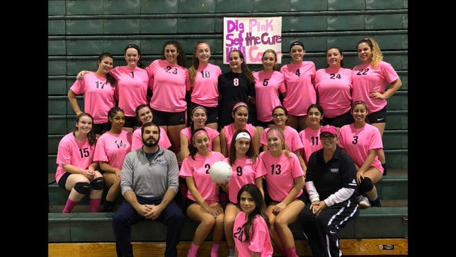 Hornets enjoying a nice moment after a hard-fought, three-set win over West Milford at home Oct. 16 in a conference game which also recognized breast cancer awareness.