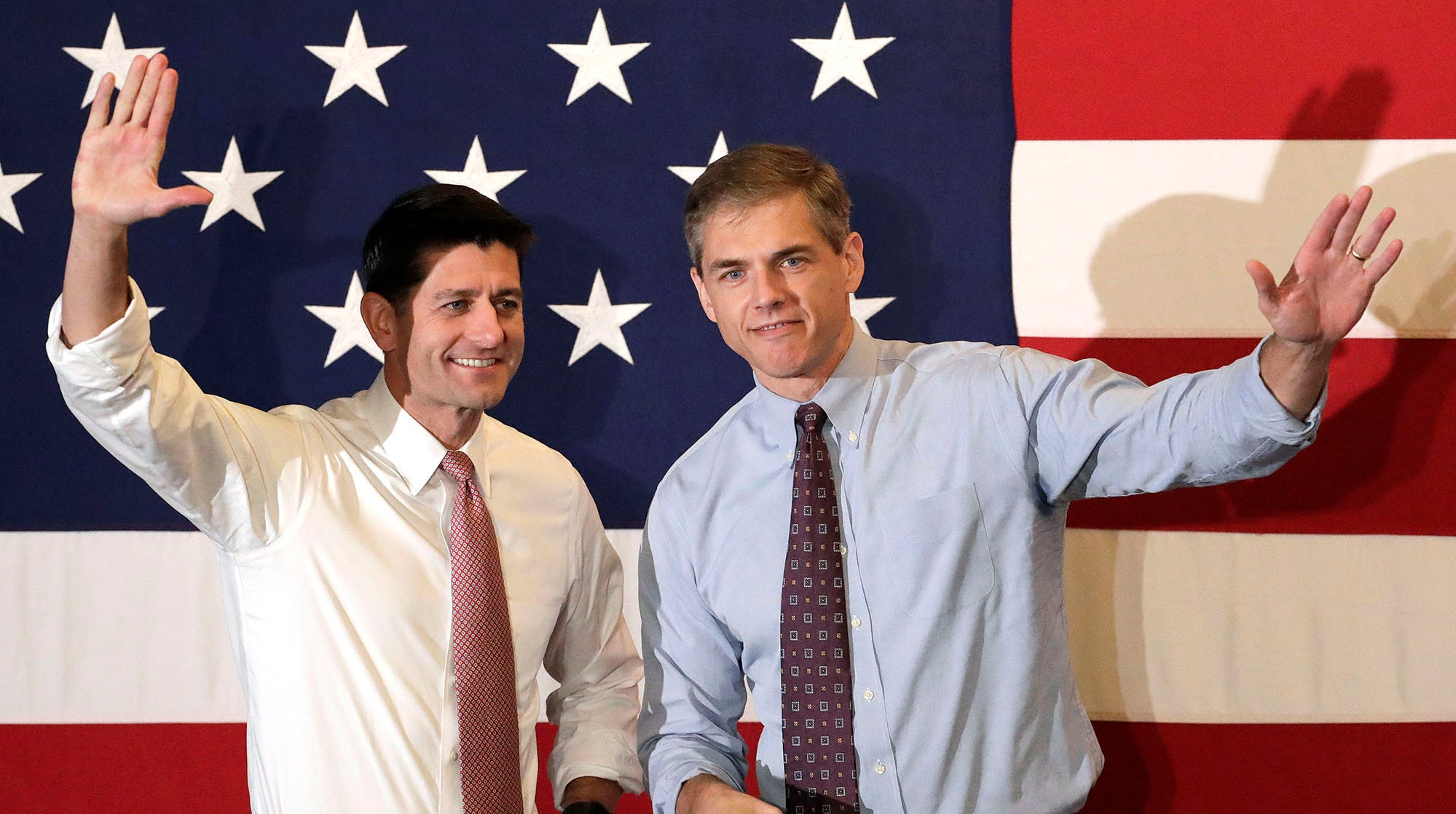 U.S. House Speaker Paul Ryan, left, and Jay Webber, Republican candidate for Congress in the 11th District of New Jersey, greet supporters during a campaign event, Wednesday, Oct. 17, 2018, in Hanover, N.J. (AP Photo/Julio Cortez)
