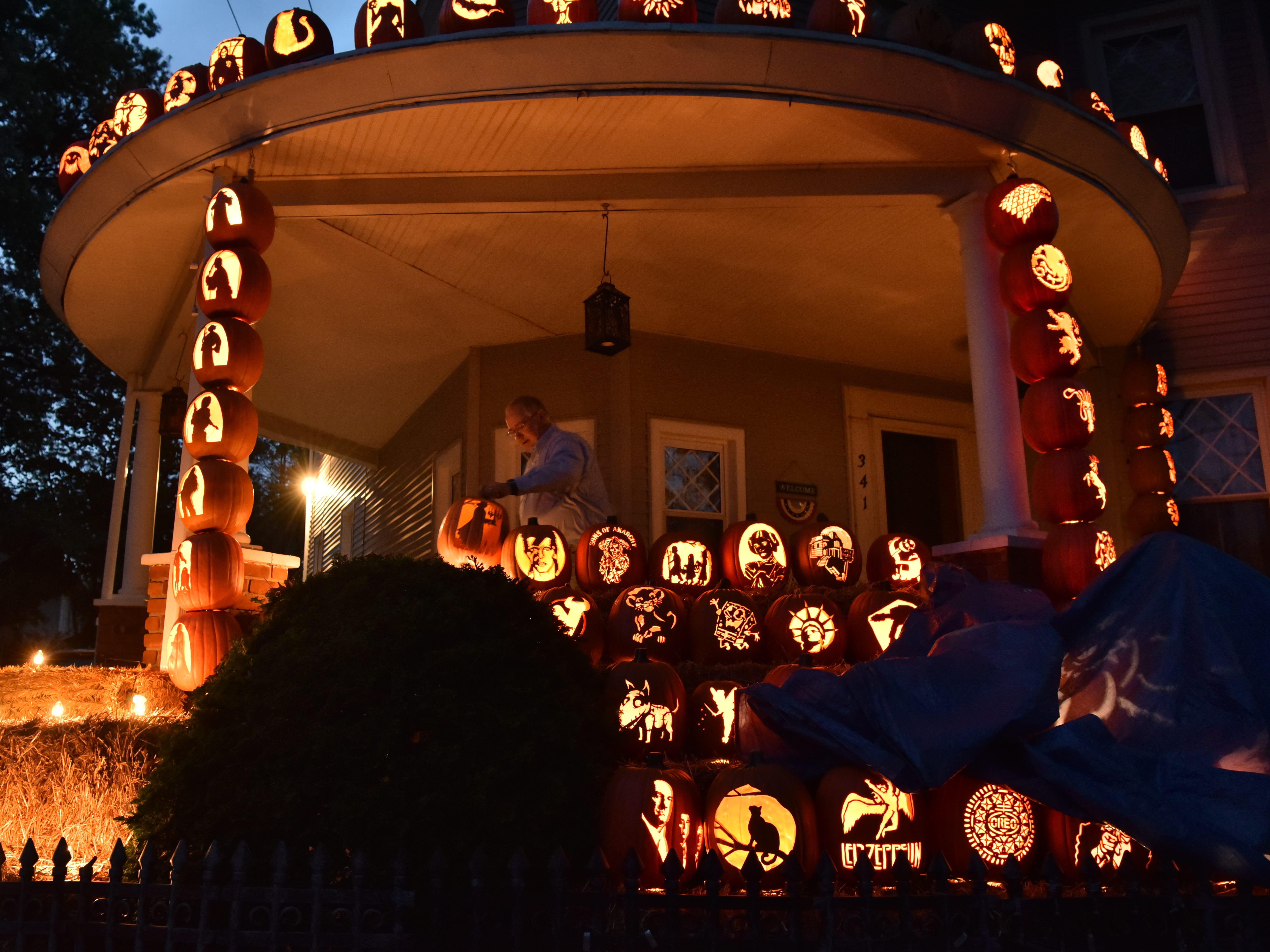 Michael Kemezis, decorates his home with jack o lantern Halloween decorations in Hackensack, on Tuesday, October 16, 2018.