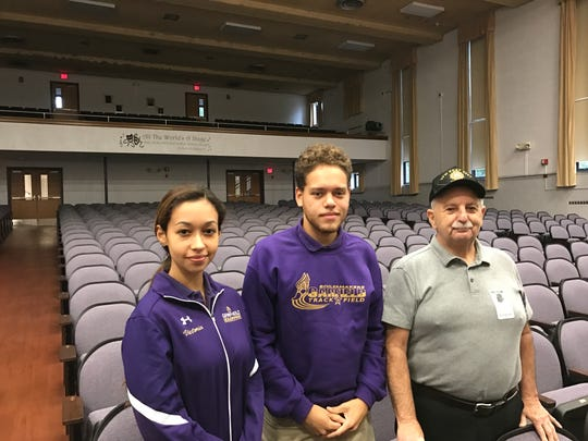 Garfield High School seniors Victoria Drzymala and Freddy Suarez with Vietnam veteran Marinus Camiscioli