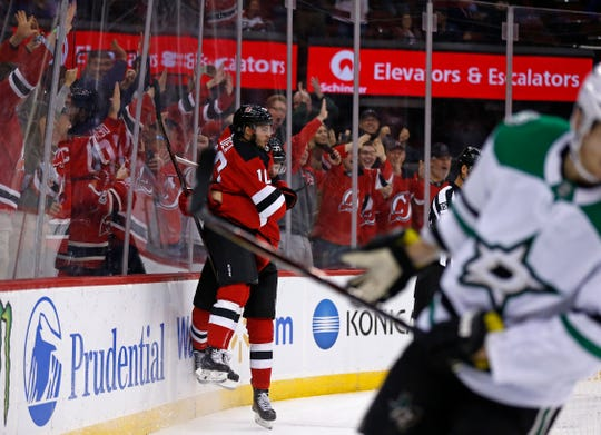 New Jersey Devils' Jean-Sebastien Dea (10) celebrates scoring a goal against the Dallas Stars in the second period of an NHL hockey game, Tuesday, Oct. 16, 2018, in Newark.