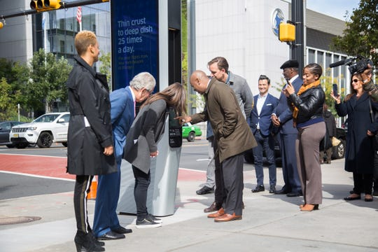 Newark Mayor Ras Barak inspects one of LinkNWK's new wireless internet kiosks. Newark is now the second city in the country to have free wifi